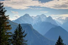 Snow-covered Triglav peak above pine forests, Julian Alps Royalty Free Stock Photography