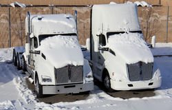 Snow Covered Trucks Stock Photo