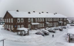 Snow covered Typical English Terraced Houses Townhouse during snowfall royalty free stock photos