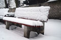 Snow covered up bench Royalty Free Stock Image
