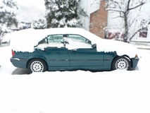 Snow covered vehicle 2. Photo of a snow covered vehicle in home driveway during a winter snow storm stock photo
