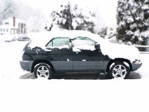 Snow covered vehicle Stock Image