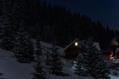 House in the mountains. Night winter landscape. A snow-covered village at the foot of the Carpathian Mountains. Carpathian mountains. Ukraine Stock Photo