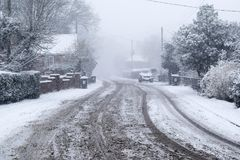 Snowy rural village road royalty free stock images