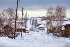 Snow-covered village street in Russian old-believer village Visim. Sverdlovsk region, Russia/. Snow-covered village street in Russian old-believer village Visim stock photography