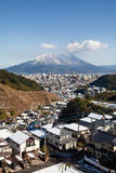 Snow covered volcano Mount Sakurajima erupts Stock Photo