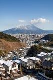 Snow covered volcano Mount Sakurajima erupts Stock Photo