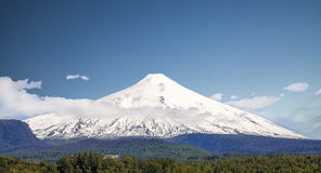 Snow covered Volcano Villarica, Chile. Villarica is one of active volcanos in. Chile Stock Images