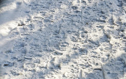 Snow-covered way with many foot prints Royalty Free Stock Photos