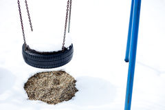 Snow covered wheel swing Royalty Free Stock Photography