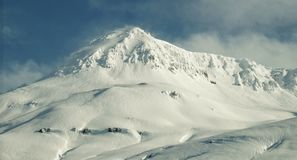 Snow covered mountain in Iceland. Snow covered white mountain, Iceland royalty free stock photography
