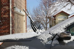 Snow covered windshield wipers Royalty Free Stock Photography