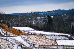 Snow covered winter fields with fences overlooking the foothills of Tennessee