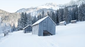 Snow covered winter landscape. Romantic wood hut in winter snow covered nature Stock Image