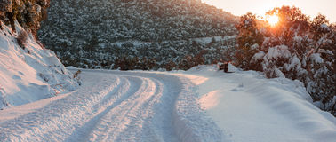 Snow covered winter road Royalty Free Stock Photos