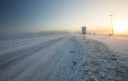 Snow Covered Winter Road With Diminshing Perspective royalty free stock photography