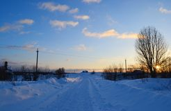Snow covered winter road at sunset Royalty Free Stock Photography