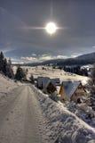 Snow covered winter ski center Stock Photos