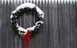 Snow covered Winter Wreath Royalty Free Stock Image