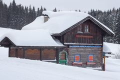 Snow covered wood hut. In austrian alps Stock Photos