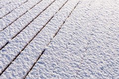 Snow covered wood terrace floor Royalty Free Stock Image