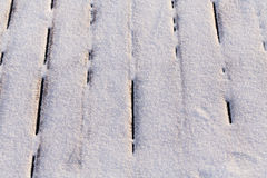 Snow covered wood terrace Royalty Free Stock Images