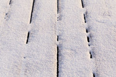 Snow covered wood terrace Stock Images