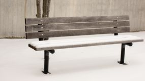Snow Covered Wooden Bench Royalty Free Stock Image