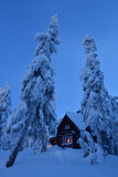 Snow covered wooden cottage on Mt. Seymour ski resort Stock Images
