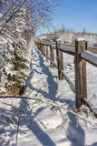 Snow Covered Wooden Fence Royalty Free Stock Image