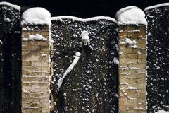 Snow covered wooden fence and door close-up royalty free stock images