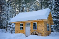 Snow Covered Wooden House Inside Forest Royalty Free Stock Photo