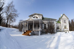 Snow-covered Wooden House On A Winter Day Royalty Free Stock Images