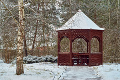 Snow covered wooden pavilion Stock Image