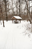 Snow covered wooden pavilion in urban park Stock Photo
