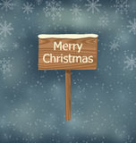 Snow covered wooden sign, Merry Christmas background Royalty Free Stock Images