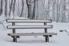 Snow covered wooden sitting bench in park 4 Stock Photography