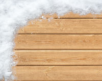 Snow-covered wooden surface Stock Image