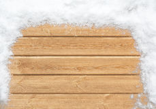 Snow-covered wooden surface Stock Photos
