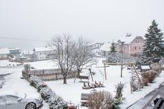 Snow-covered yard in alpine village Stock Photo