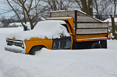 Snow Covered Yellow Pick Up Truck Royalty Free Stock Image