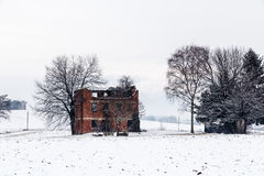 Snow covering an abandoned farm Stock Image
