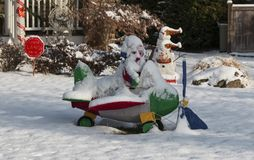 Snow Covering Christmas Decorations On Front Lawn Royalty Free Stock Images
