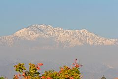 Mount San Antonio, Los Angeles, CA, USA. Snow covering Mount San Antonio in winter from Montclair in Greater Los Angeles, California, USA royalty free stock photos