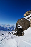 Snow covering rocks. At the peak of the mountain Stock Images