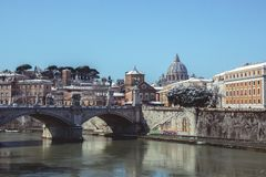 Vatican Approach. Snow covers the bridge leading to St. Peter`s Basilica in the Vatican, seen from St. Angelo`s Bridge Stock Images