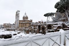 Snow covers the streets of Rome, Italy. Forum of Ciulio Cesare. Rome, Italy - February 26, 2018: An exceptional weather event causes a cold and cold air across stock photography