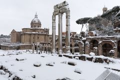 Snow covers the streets of Rome, Italy. Forum of Julius Caesar. Rome, Italy - February 26, 2018: An exceptional weather event causes a cold and cold air across royalty free stock photo