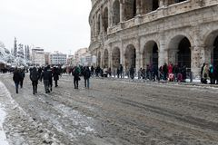 Snow covers the streets of Rome, Italy. Piazza del Colosseo come royalty free stock photos