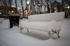 Snow cowered bench Royalty Free Stock Photo
